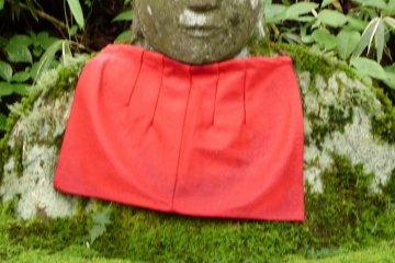 Moss covered Jizo stone statue