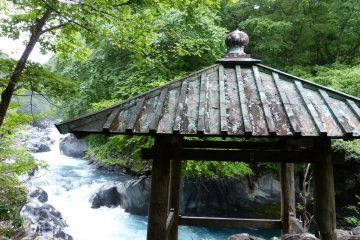 The prayer platform sits on a rock jutting out over the river