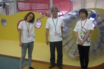 Staff in front of a clear rolling wheel that kids older than three can try out