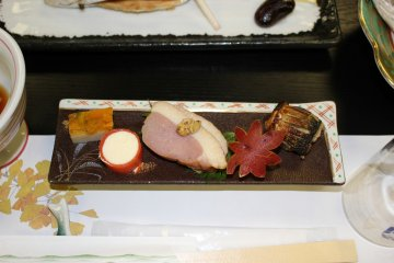 <p>Egg, salmon lox wrapped cream cheese, duck breast with mustard, sweet potato carved like a maple leaf and vegetable stuffed fish</p>