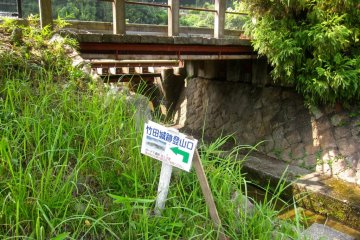 The sign for the hiking trail near the entrance to Takeda Station