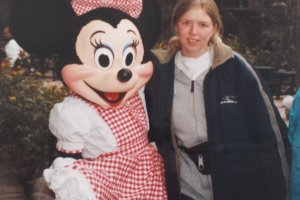 Nele in her first Disney character photo with Minnie Mouse