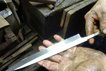 A knife in the making at a blacksmith's workshop in Sakai