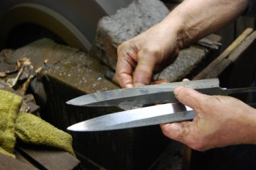 Knives at different stages of polishing