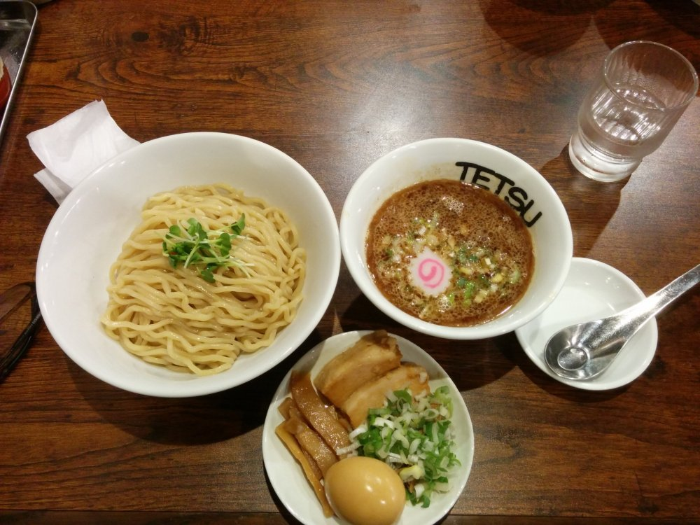 A tsukemen set with boiled egg and sliced pork