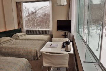 There are rooms to suit every budget.  This is a simple triple room with great windows.