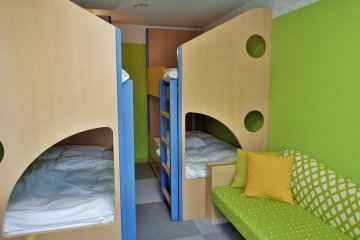 The 4-bunk bed room is popular with families with children.