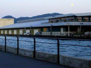 The early evening moon above Numazu Port