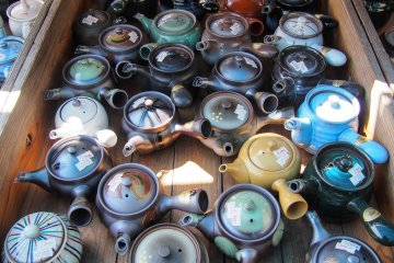 Teapots for sale at the market outside the museum.