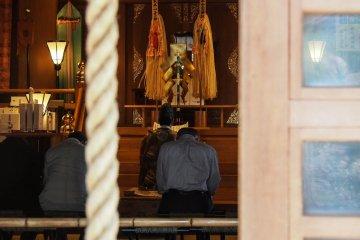 Praying inside the shrine.