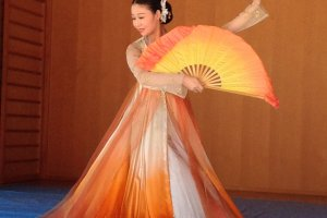 Graceful flowing robes in a Korean inspired dance