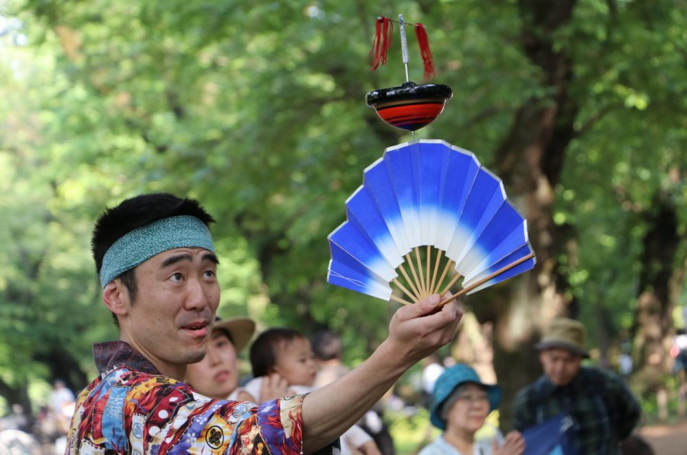 Spinning top on Japanese fan