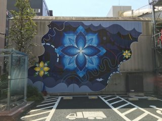 A collaborative work by HITOTZUKI, which stands for the sun and moon - this artwork is just opposite the sumo wrestler