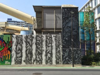 a long wall of street art can be found along Bond Street. This artwork is a collaboration by Fafi and Kamea Hadar