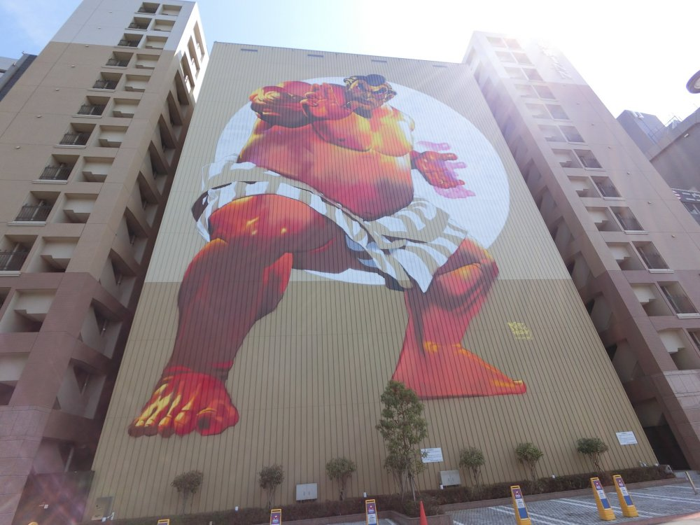 A giant 12-story high sumo wrestler by German artist, Case Maclaim, took 47 hours to paint for Powwow Japan in 2015