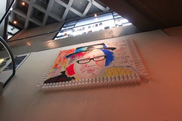An illustration of Sion Sono in the basement of Watari-um