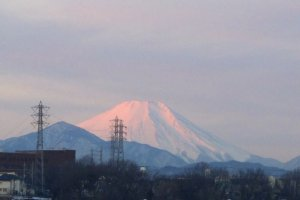 The first rays of sunrise hit Mt. Fuji for a few precious minutes