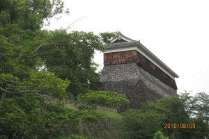This turret on the outermost wall looks to be a minimum of 5 stories above the moat
