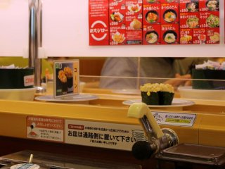 Sushi dishes are served via the rolling conveyor belt.