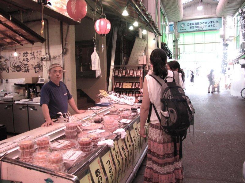 Visitors explore the Omi-cho market