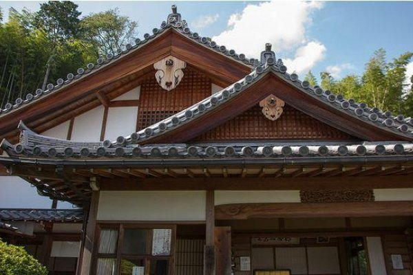 Suzumushi Temple\'s natural hues allow it to blend in easily with nature.