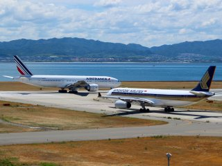 2 planes preparing for take off at Kansai International Airport.