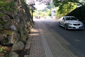 <p>The stone walls to the entrance of the parking lot were once the walls of Nenoman Gate</p>
