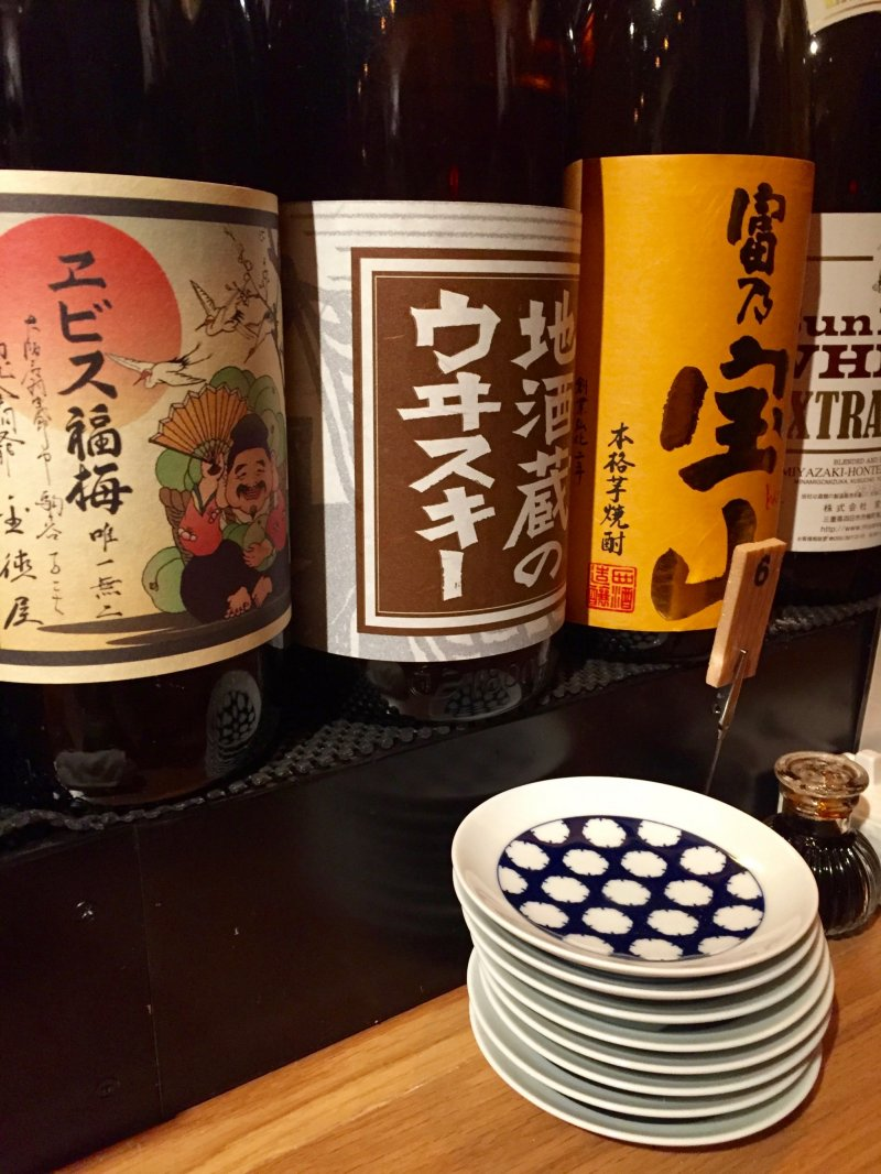 Big bottles with sake, whiskey, and plum liquor