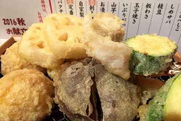 Our order - renkon, shiitake mushrooms, zukkini, egg, shrimp, and fish tempura