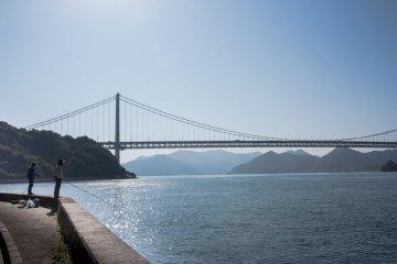 Locals fishing in front of Innoshima Bridge