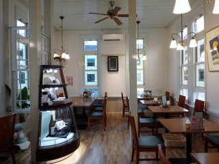 The indoor cafe space is comfortable and inviting.