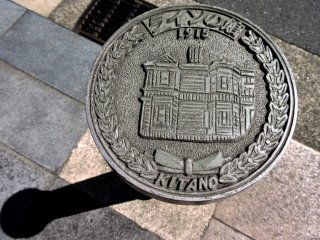 Various metal plaques with historical buildings on them could be seen along one street