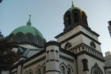 Distinct green domes stand out in the area's modern skyline