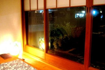 Private dining room with wood decor and view of the Takasegawa canal in Kiyomachi south of Shijo Kyoto