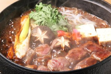 Horse sukiyaki, prepared and served by the restaurant staff at your table