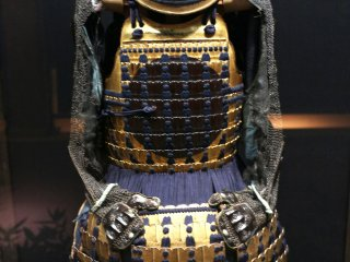 A set of traditional full armor that a samurai might wear