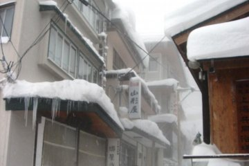 Icicles grow long from the roofs of the houses in Zao Onsen in winter