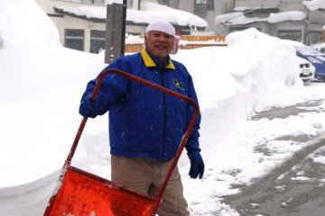 The locals try their best to remove the snow from streets, passageways and car parks