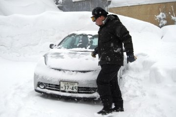Masses of snow easily bury your car, if you are not careful