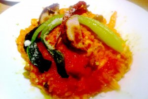 Delicious and colorful risotto with eggplant and grated cheese at Kitchen Kanra