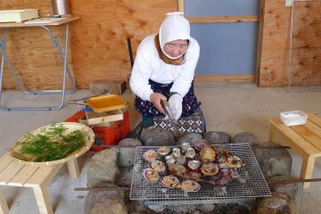 Lunch is served by women in traditonal divers' outfits
