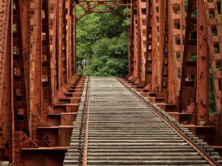 Crossing an abandoned railway bridge.