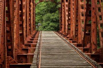 Crossing an abandoned railway bridge.