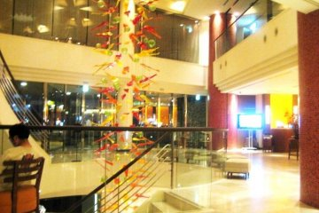 Lobby at Hotel Nahana which is located on the main road north of the airport near Kenchomae Monorail and Kokusai dori