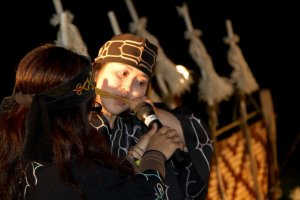 Playing the Mukkuri, which is a traditional jaw harp usually made of bamboo