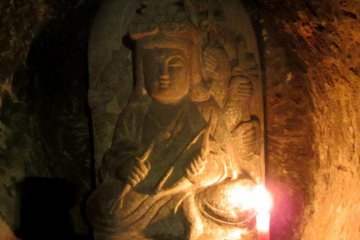 Each statue is also lit by candles, which you can purchase and place at the base of the one you are praying to