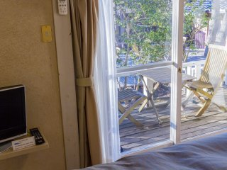 Step out of bed and onto the wooden deck