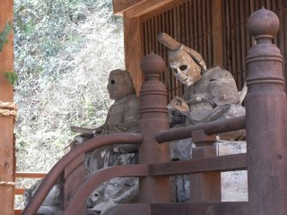 Old eyeless wooden statues