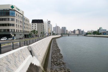 Tenma River, flanked by open walkways and parkland.