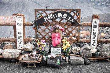 A Jizo statue placed at the main entrance of Mount Aso's main crater